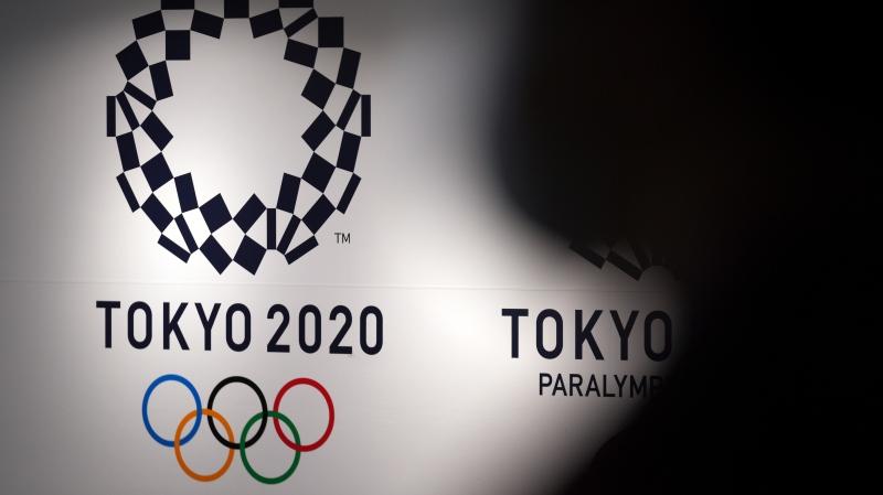 A person walks near Tokyo 2020 logo in Haneda Airport Monday, June 14, 2021, in Tokyo. (AP Photo/Eugene Hoshiko)