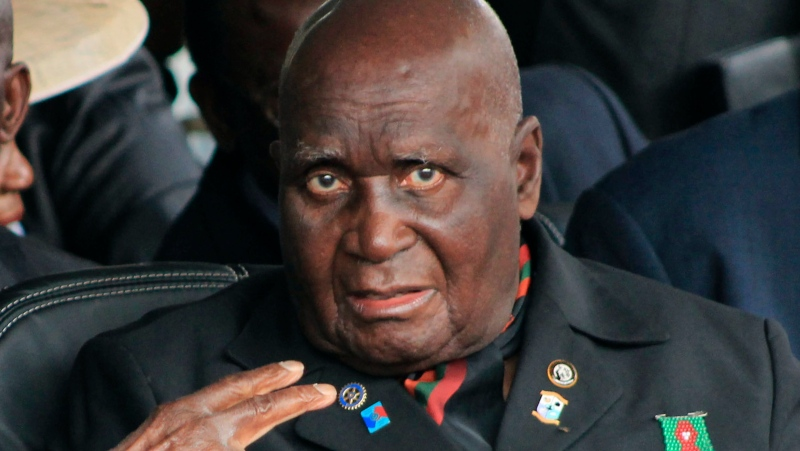In this Jan. 25, 2015 file photo, former Zambian president, Kenneth Kaunda, attends the inauguration ceremony of the Patriotic Front's Edgar Lungu, in Lusaka. The country's first president, Kaunda, 97, has been admitted to hospital, his office announced Monday, June 14, 2021, as the southern African country battles a surge in COVID-19. (AP Photo/Moses Mwape, File)