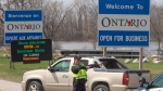 Ontario Provincial Police check travellers entering Ontario from Quebec as new COVID-19 measures take effect Monday, April 19, 2021 in Hawkesbury, Ontario. (The Canadian Press)
