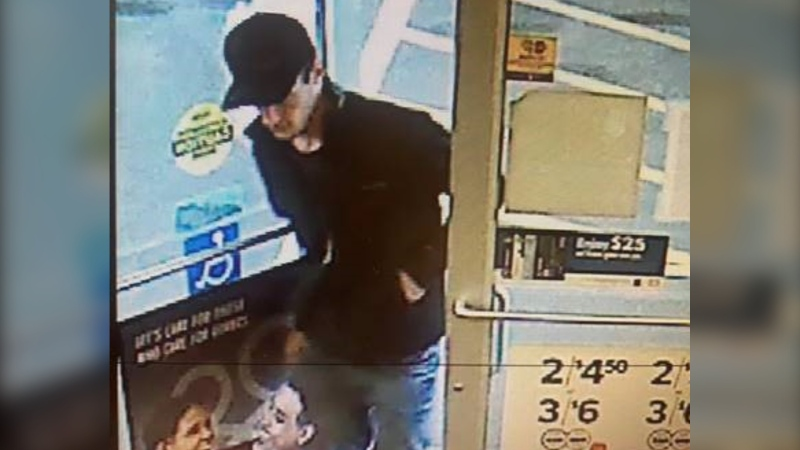 RCMP are attempting to identify the man in this surveillance image in connection with the theft of a car, the use of a stolen debit card and a car prowling in High River. (RCMP)
