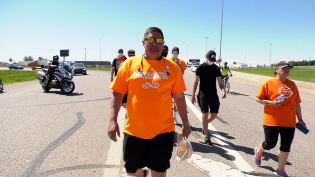 STC Chief Mark Arcand is pictured walking Circle Drive on June 14, 2021. (Chad Hills/CTV Saskatoon)