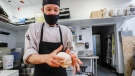 Desmond Verinder, prepares pizza dough at PZA restaurant as Alberta takes a major step toward reopening as Stage 2 of its plan begins in Calgary, Alta., Thursday, June 10, 2021. THE CANADIAN PRESS/Jeff McIntosh