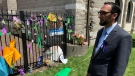 Asad Choudhary, principal at the London Islamic School attended by Fayez Afzaal, looks at a memorial outside the London Muslim Mosque in London, Ont. on Monday, June 14, 2021. (Bryan Bicknell / CTV News)