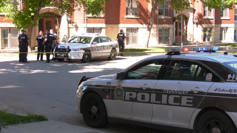 Winnipeg police investigate after a man was found suffering from a gunshot wound in the area of Balmoral Street and Young Street on June 14, 2021 (CTV News Photo Glenn Pismenny)