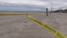 Crime scene tape remains near where Mustafa Khaleel's body was found on Beach Area 1 in Wasaga Beach, Ont. on Mon., June 14, 2021 (Siobhan Morris/CTV News)