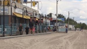 Visitors return to Beach Area 1 after weekend violence on Mon., June 14, 2021 (Siobhan Morris/CTV News)