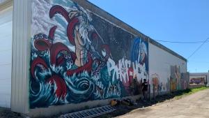 Kiel Smith, has created a Greek mythology mural as part of the new Regina Free Wall project. (Andrew Benson/CTV News)