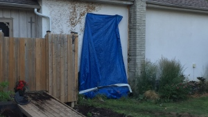 A house on Churchill Drive in Cambridge was damaged after a pickup truck drove into it Monday afternoon. (CTV Kitchener)
