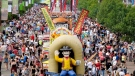 Crowds walk along the midway at the Calgary Stampede in Calgary, Sunday, July 9, 2017. Stampede will be a modified version in 2021, with smaller attendance, fewer off-site parties and pancake breakfasts. THE CANADIAN PRESS/Jeff McIntosh.
