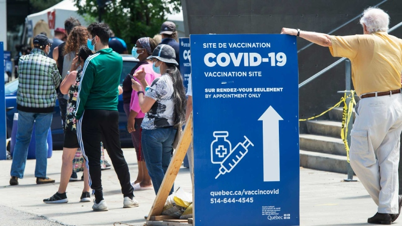 People line up to get their COVID-19 vaccine at a vaccination centre, Thursday, June 10, 2021 in Montreal. THE CANADIAN PRESS/Ryan Remiorz