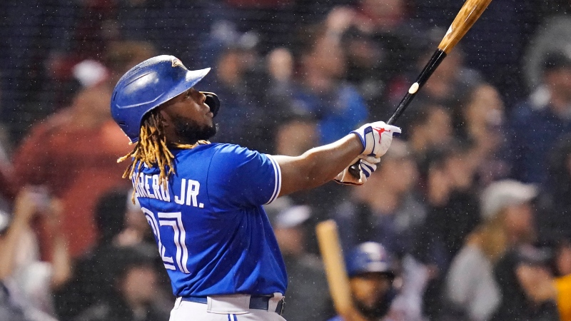 Toronto Blue Jays designated hitter Vladimir Guerrero Jr. watches his solo home run, tying the game at 1-1, in the top of the ninth inning of a baseball game against the Boston Red Sox at Fenway Park, Monday, June 14, 2021, in Boston. (AP Photo/Charles Krupa)