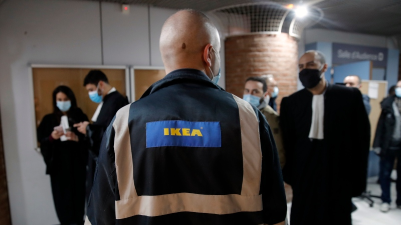 An Ikea employee and lawyers arrive at the Versailles' courthouse, outside Paris, Monday, March 22, 2021. (AP Photo/Christophe Ena)