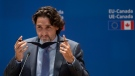 Canadian Prime Minister Justin Trudeau removes his mask at the beginning of the EU-Canada Summit Monday June 14, 2021 in Brussels, Belgium. (THE CANADIAN PRESS/Adrian Wyld)