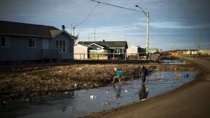 Indigenous children play in Attawapiskat, Ont. on April 19, 2016. (THE CANADIAN PRESS/Nathan Denette)