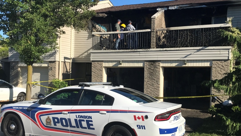 Investigators go through the scene of a multi-unit townhouse fire in London, Ont. on Tuesday, June 15, 2021. (Sean Irvine / CTV London)
