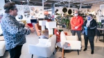 A sales clerk keeps his distance from clients at a furniture store in St-Jean-sur-Richelieu, Que. on Monday, May 4, 2020. THE CANADIAN PRESS/Paul Chiasson
