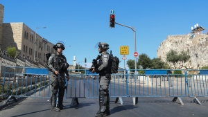 Israeli border police block a main road ahead of a planned march by Jewish ultranationalists through east Jerusalem, outside Jerusalem's Old City, Tuesday, June 15, 2021. (AP Photo/Ariel Schalit)