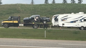 A damaged pickup truck on a flatbed truck following Tuesday morning's crash on Deerfoot Trail near 212 Avenue S.E. that sent one woman to hospital.
