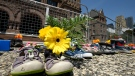 Children's shoes and flowers are shown after being placed outside the Ontario legislature in Toronto on Monday, May 31, 2021.THE CANADIAN PRESS/Frank Gunn