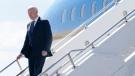 U.S. President Joe Biden steps off Air Force One at Geneva Airport in Geneva, Switzerland, Tuesday, June 15, 2021. Biden is scheduled to meet with Russian President Vladimir Putin in Geneva, Wednesday, June 16, 2021. (AP Photo/Patrick Semansky)