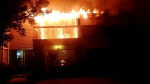 A pair of balconies are seen ablaze at units 98 and 100 at 700 Osgoode Dr. in London, Ont. (Source: Ange Senese)