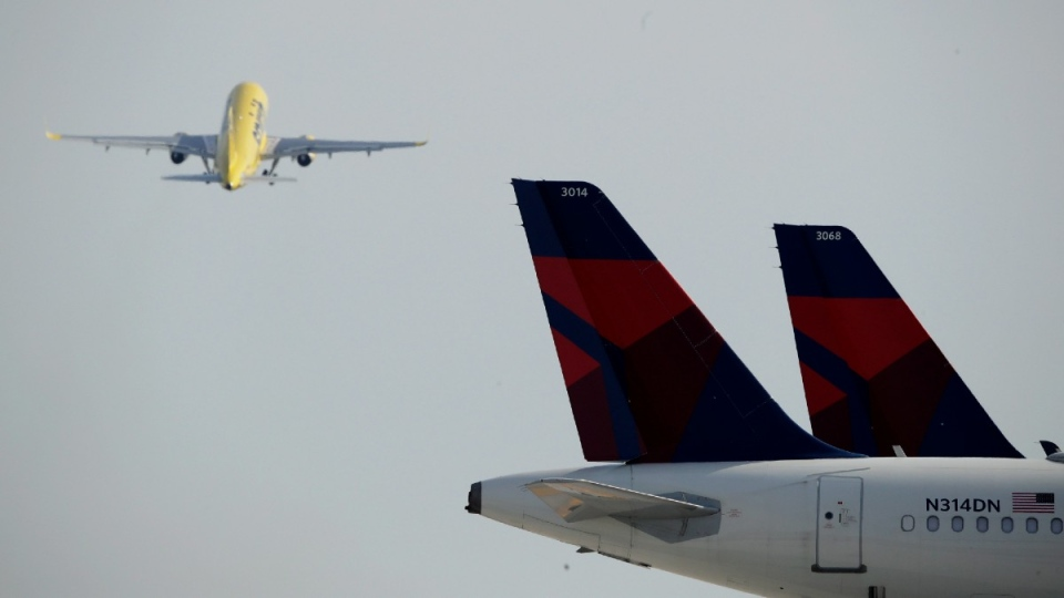 Delta Air Lines jets are seen in the foreground