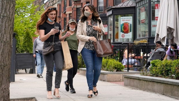 In this May 2, 2021, file photo, pedestrians walk along Boston's fashionable Newbury Street. (AP Photo/Steven Senne, File)