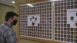 Trost looking at their graduating class' photos hung in the hall behind the main office at Yorkton Regional High School. (Kaylyn / Whibbs / CTV  News Yorkton)