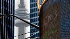 A sign board displays the TSX record first close over 20,000 points in Toronto, Friday, June 4, 2021. THE CANADIAN PRESS/Frank Gunn