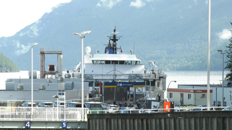 A BC Ferries vessel is seen at the Horseshoe Bay terminal on Tuesday, June 15, 2021, the day B.C. reopened non-essential travel provincewide.