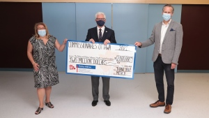 Commissionaires Ottawa present the Perley and Rideau Veterans' Health Centre with a $2 million donation toward the Centre of Excellence in Frailty-Informed Care. June 15, 2021. From left to right: Delphine Haslé, Executive Director, Perley and Rideau Veterans' Health Centre Foundation; Captain (N) Paul A. Guindon (Ret'd), CEO, Commissionaires Ottawa; Akos Hoffer, CEO, The Perley and Rideau Veterans' Health Centre. (Photo provided by the Perley and Rideau Veterans' Health Centre)