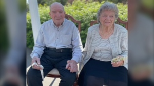 Walter and Lil Parniak are celebrating 75 years of marriage on June 15/21. They are both holding items from their wedding day, she is holding is her wax flower headpiece and he is holding his bow tie. (Mary Ellen Wenmann)