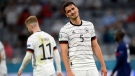 Germany's Mats Hummels reacts during the Euro 2020 soccer championship group F match between France and Germany at the Allianz Arena stadium in Munich, Tuesday, June 15, 2021. (Matthias Hangst/Pool via AP)