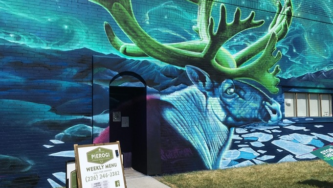New mural by local artist David Derkatz (a.k.a. DERKZ) and Toronto-based artists, Nick Sweetman and Moises Frank in South Walkerville in Windsor, Ont. on Tuesday, June 15, 2021. (Gary Archibald/CTV Windsor)