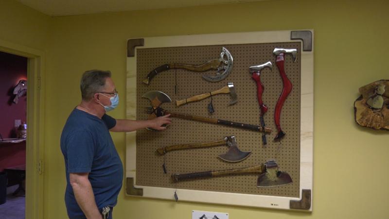 Dan Hudon, an axe maker also known as Dan the Axe Man, shows off part of his collection. (CTV News Edmonton)