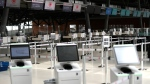Air Canada's check in counters and kiosks are seen on the departures level of the Ottawa Airport in Ottawa, on Monday, June 14, 2021. THE CANADIAN PRESS/Justin Tang