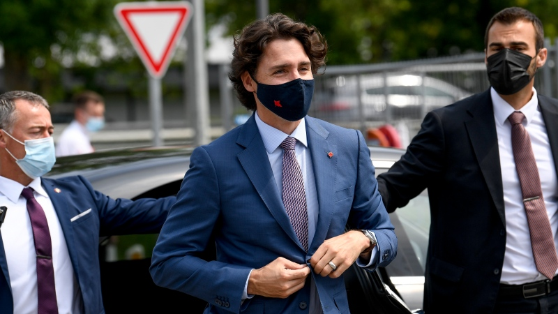 Prime Minister Justin Trudeau arrives for a working visit to the Pfizer pharmaceutical company in Puurs, Belgium, Tuesday, June 15, 2021. (Frederic Sierakowski, Pool via AP)