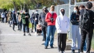 Young people line up for COVID-19 vaccines at Downsview Arena in Toronto on Monday, May 10, 2021. Ontario has just opened up vaccines for 18+ in high risk areas. THE CANADIAN PRESS/Frank Gunn