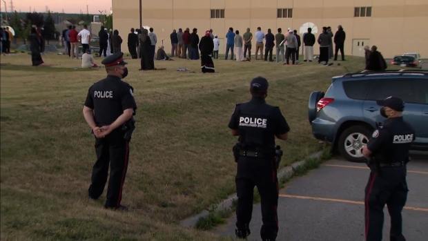 Toronto Police officers watch over nightly prayers Tuesday evening at the Islamic Institute of Toronto.