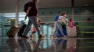 In this Monday, June 7, 2021 file photo, tourists arrive at Barcelona airport, Spain. Europe is opening up to Americans and other visitors after more than a year of COVID-induced restrictions. European governments hope to lure back tourists - and their dollars - back to the continent's trattorias, vistas and cultural treasures. (AP Photo/Emilio Morenatti, File)