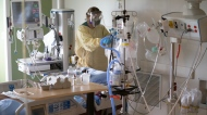 A nurse attends to a patient in the COVID-19 Intensive Care Unit at Surrey Memorial Hospital in Surrey, B.C., Friday, June 4, 2021. THE CANADIAN PRESS/Jonathan Haywar
