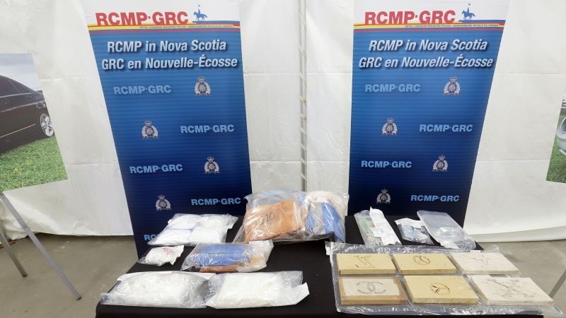 Nova Scotia RCMP has arrested 14 people and seized a 'significant quantity of drugs, firearms and money,' after police say they disrupted a drug trafficking ring as the result of an 11-month investigation. (Photo via N.S. RCMP)
