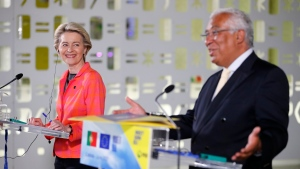 European Commission President Ursula von der Leyen smiles during a joint news conference with Portuguese Prime Minister Antonio Costa, right, at the Center for Living Science in Lisbon, Wednesday, June 16, 2021. (AP Photo/Armando Franca)