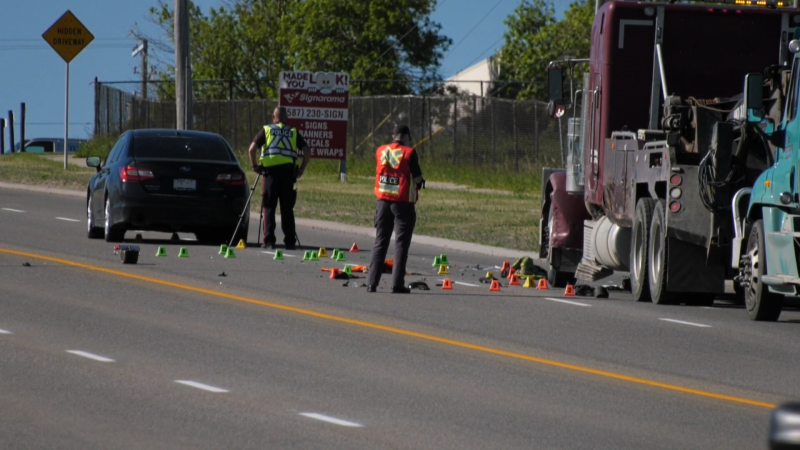 CPS members at the scene of Wednesday morning's collision where a car hit a tow truck operator along 11th St. N.E.