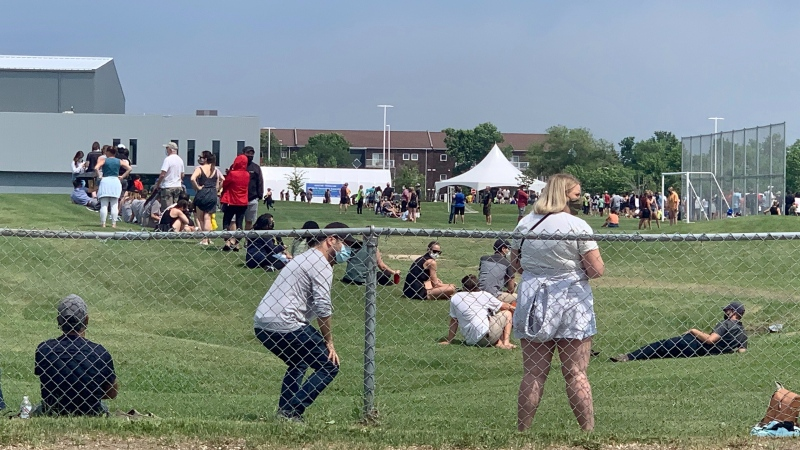 Winnipeggers line up outside of the Leila Avenue supersite to receive a COVID-19 vaccine at a walk-in clinic on June 16, 2021. (CTV News Photo Scott Andersson)