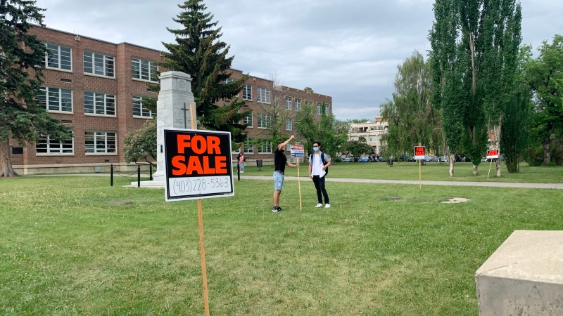 Students put 'For Sale' signs up at Western Canada High School as part of a graduation prank. (Contributed)