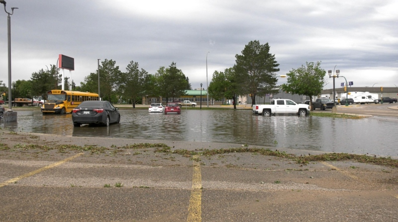 The Gateway Mall parking lot was left flooded after a June 16, 2021 storm. (Lisa Risom/CTV News)