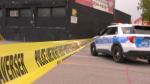 Winnipeg police respond to an assault on Dufferin Avenue and Main Street that sent a man to hospital on June 16, 2021. (CTV News Photo Glenn Pismenny)
