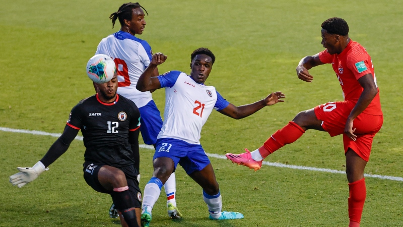 Canada's Jonathan David (20) tries to score against Haiti's Josue Duverger (12) and Bryan Alceus (21) during the first half of a World Cup qualifying soccer match Tuesday, June 15, 2021, in Bridgeview, Ill. (AP Photo/Kamil Krzaczynski)