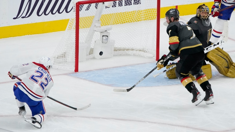 Montreal Canadiens right wing Cole Caufield (22) scores a goal against Vegas Golden Knights goaltender Marc-Andre Fleury (29) during the second period in Game 1 of an NHL hockey Stanley Cup semifinal playoff series Monday, June 14, 2021, in Las Vegas. (AP Photo/John Locher)